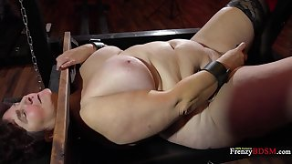BBW bitch is locked around the pillory and she's ready to do whatever she's told