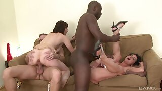 Wives shares by their bodies in stony foursome on a couch